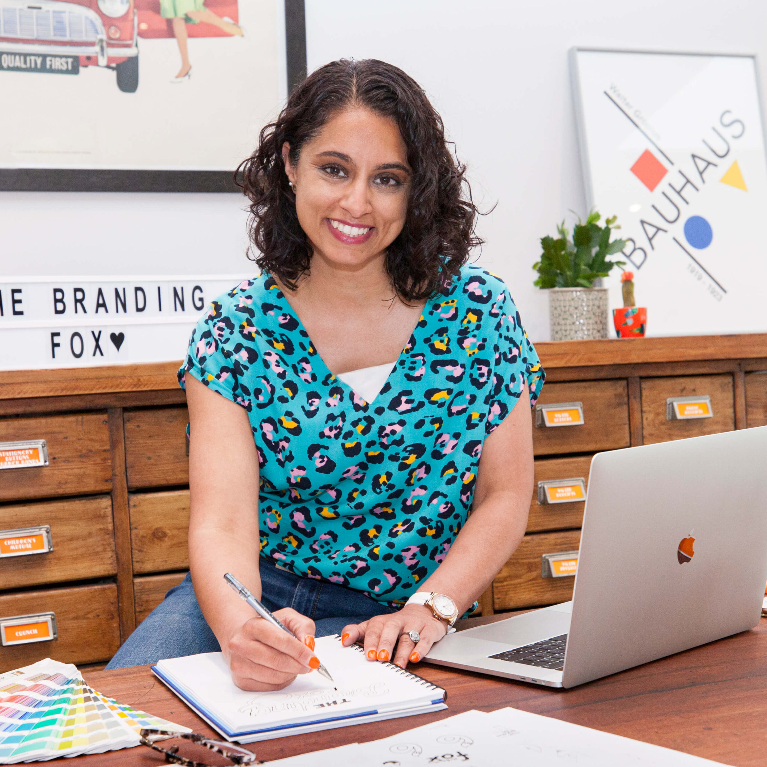 A photo of Vardeep at her desk